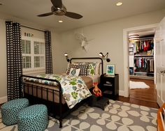 The wonderful Huggar fan by Modern fan is perfect for a boys room and the Stray Dog Designs striped drum looks adorable in this closet!