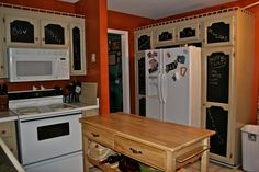 Kitchen cabinets with chalkboard panels ... hmm. (from A Cheery Disposition)