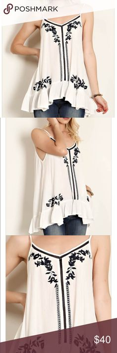 ✨Embroidery Accent Ruffle Cami Top •Pictures truly show how gorgeous this shirt is! Beautiful embroidery + the gorgeous ruffles at the bottom. Can this get any better?                           Material 100% Rayon Tops Camisoles