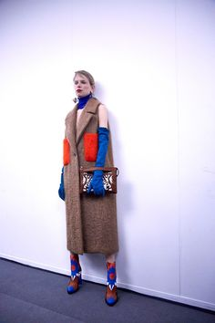 Wool sleeveless coat and bright cowboy like boots at MSGM AW15 MFW. See more here: http://www.dazeddigital.com/fashion/article/23895/1/msgm-aw15