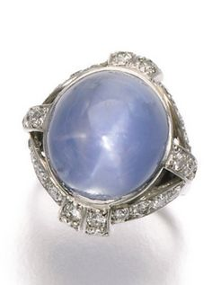 Star sapphire and diamond ring, 1930s The star sapphire set within an open work mount accented with circular-cut diamonds, size J.