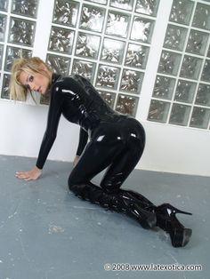 Natasha wearing a shiny latex catsuit