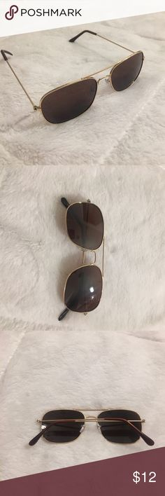 Trendy Gold Trim Sun Glasses Nice pair of sun glasses with gold trim. Like new. Never worn Accessories Glasses