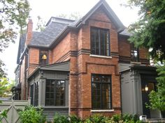 Historic red brick home with grey addition. qummunicate.com Toronto