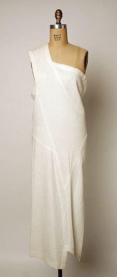 Dress Design House: Comme des Garçons (Japanese, founded 1969) Designer: Rei Kawakubo (Japanese, born 1942) Date: 1986 Culture: Japanese Medium: synthetic Dimensions: Length at CB: 41 in. (104.1 cm)