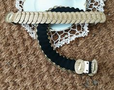 Check out this item in my Etsy shop https://www.etsy.com/listing/186689030/retro-stretchy-gold-medallion-belt