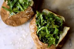 Sea Salt Baked Potatoes: I love this baked potato recipe, topped with well-dressed arugula. A healthier take on the traditional baked potato. Crispy jackets split open to reveal a fluffy white potato interior. **simply inspiration for baked potato Salted Baked Potato, Baked Potato Recipes, Vegetarian Recipes, Cooking Recipes, Healthy Recipes, Cooking Tips, Batata Potato, Great Recipes, Favorite Recipes