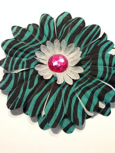 Zebra Print Dog Collar Flower is available for your favorite pet.  Visit or Facebook page: Isabella's Pet Shop  Thank you!
