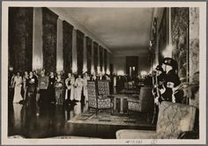 """Original caption: """"The Supreme Commander and commanding generals of the Army and the Air Force as well as the Admirals of the Navy and their wives were guests of the Fuhrer in the new Reichs Chancellery."""" This new building was completed in 1940 and cost the equivalent of $1 billion in today's money.The building was designed by Albert Speer, who also oversaw the construction.The chancellery was heavily damaged during the Battle of Berlin and what remained was leveled by the Soviets."""