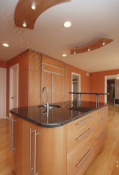 Custom cabinetry , island lighting, concealed appliances, soft close units.