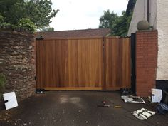 One side used as a pedestrian gate. Constructed from iroko hardwood timber. Driveway Landscaping, Driveway Gate, Wrought Iron Gates, Wood Gates, Fence Gates, Fencing, Wooden Garden Gate, Gardening For Dummies, Garden Oasis