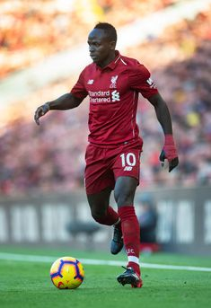 Sadio Mane of Liverpool in action during the Premier League match between Liverpool FC and Cardiff City at Anfield on October 2018 in Liverpool, United Kingdom. Get premium, high resolution news photos at Getty Images Liverpool Live, Arsenal Liverpool, Salah Liverpool, Liverpool Players, Liverpool England, Premier League News, Premier League Matches, Fotografia, Fc Bayern Munich