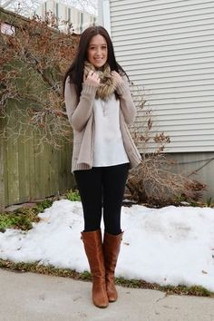 White Top, light Tan Cardigan, Black Leggings and Knee High Brown Boots.
