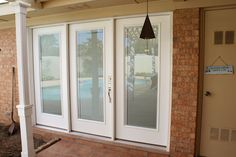 how cool is this?!  Looks like a slider, but hinged door!! This blog says buy the door/window you want and hire your own contractor to install it!!@Sarah Haverly