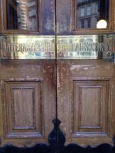 Beautifully-polished sign across the doors at the Newcastle Literary and Philosophical Society. July 2014.