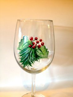 Holly painted wine glass