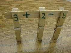 Kids develop math concepts and fine motor skills as they build math facts using clothespins and craft sticks! (Free ideas also included for helping kids work with fact families and missing addends.) @Courtney Baker Baker Baker Ayo