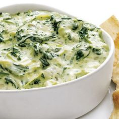 Need a little dip for your picnic? Slow cook this spinach artichoke dip beforehand and then take it with you to enjoy! #CrockPot #Picnic #Ideas
