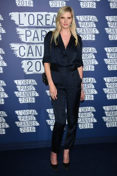 Simple sophistication. Lara Stone wearing a TRUSSARDI silk jumpsuit from the Fall Winter 2016/17 collection at the L'Oréal Paris Blue Obsession party during the 69th Cannes Film Festival