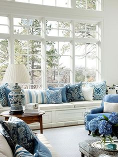 Beautiful windows with blue pillow accents