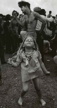 A young girl dancing at Woodstock.