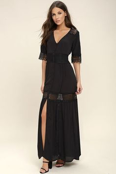 Save the best for last in the Amuse Society Last Call Black Lace Maxi Dress! Lightweight, gauzy fabric with eyelash lace and embroidered trim is formed to a short sleeve bodice. Full button placket travels from a V-neck down the maxi skirt with front slit.