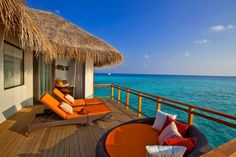Great Interior Design to Enjoy the Earth Paradise in Velassaru: The Veranda With Orange Sunbed Of Velassaru Resort