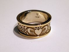 """""""Handmade Celtic Rings & Custom Jewellery. Exclusively in Platinum, Gold or Silver. Jason Bellchamber, Custom Goldsmith."""" Shown: Eternity Triskele Claddagh in 14 K White and the Riased Edges sets it off. -- Some exquisite work on this site!"""