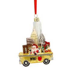 NYC Landmarks Taxi Christmas Ornament Bring one of the most memorable sights of the City home with our NYC Taxi Glass Ornament. This glittered glass ornament will brighten up any tree.  The golden yellow taxi is transporting some precious cargo - Freedom Tower, Empire State Building, Chrysler Building, Brooklyn Bridge, Flatiron Building, Times Square and Broadway! (http://www.nycwebstore.com/nyc-landmarks-taxi-glass-ornament/)