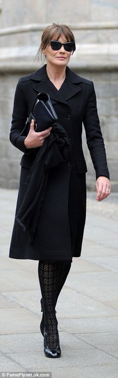 Stylish: Carla Bruni also made an appearance wore statement patterned tights and a modest ...