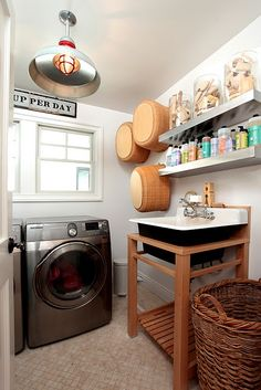 laundry room. Like the jars of brushes. Where do you find all those wooden oes, rather than the tacky, bright plastic ones, I wonder?