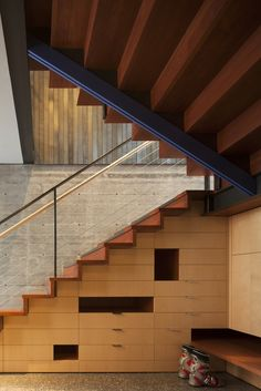 Modern home with staircase, metal tread, and wood tread. Photo 3 of Kicking Horse Residence