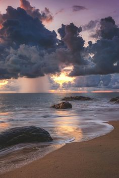 The sunlight shining through the clouds and the water coming to the shore give the a idea of a perfect utopia.
