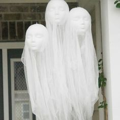 Foam mannequin heads and cheese cloth are the keys to these creepy porch decorations by Ashley Phipps of Simply Designing.