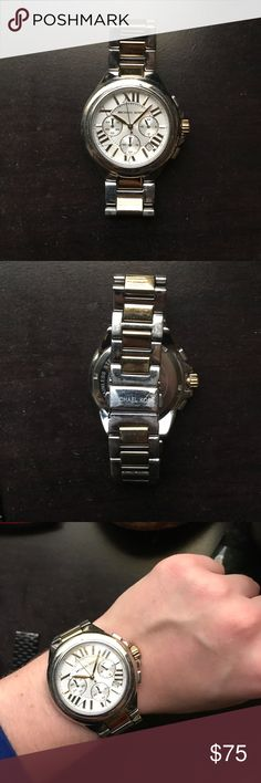 Michael Kors silver and gold watch Used Michael Kors Silver and Gold boyfriend watch. All stainless steel MK-5653 Michael Kors Accessories Watches