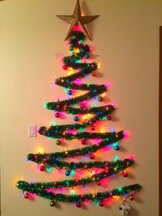 ideas lighting ideas diy wall christmas trees for 2019 Artificial fir tree as Christmas decoration? A synthetic Christmas Tree or perhaps a real one? Wall Christmas Tree, Creative Christmas Trees, Diy Christmas Lights, Simple Christmas, Christmas Crafts, Christmas Christmas, Alternative Christmas Tree, Christmas Ornament, Christmas Tree Ideas For Small Spaces