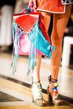 Leutton Postle on the Kris Atomic London fashion website.