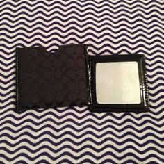 Double sided Coach Mirror with case This little duo will fit in anything! One side is a regular mirror and on the back it's a magnified mirror. Great to keep in the car or purse! Coach Accessories