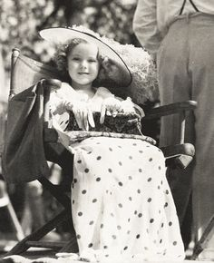 Shirley Temple behind the scenes of Bright Eyes, 1934.