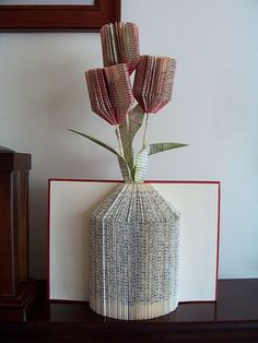 I don't think I've shared these two book folding items that I made eons ago,   A bird house and a vase with tulips.