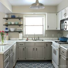 colors!! light grey counter, wood shelving over the toilet.   White Diamond Kit - Giani Countertop Paint