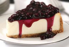 """""""This is a dense cheesecake that is very smooth and melts in your mouth. The white chocolate brandy sauce tops it off. I just nap it over the center of the slice of cheesecake on Cheesecake Day, No Bake Blueberry Cheesecake, Cheesecake Recipes, Dessert Recipes, Blueberry Topping, Classic Cheesecake, Protein Cheesecake, Blueberry Cake, Health Desserts"""
