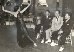 Cleveland's answer to Sally Rand, dancer Toto LeVerne, headliner at the French Casino, entertains the dapper gents at the Great Lakes Exposition 1936, by demonstrating her arts.  Promoters originally resisted the idea of burlesque style entertainment, but the popularity of such acts attracted visitors and increased ticket sales.