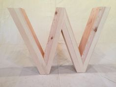 the letter W from wood salvaged from the wildfires in the Methow Valley, WA