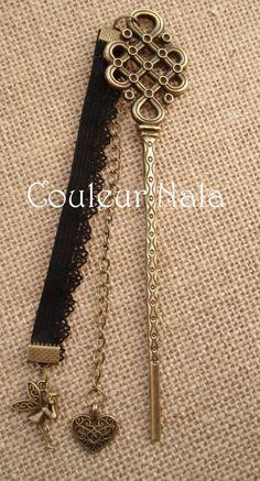 """Marque pages de 14cm, motif noeud en métal bronze, dentelle noire, breloques """"fée"""" et """"coeur dentelle"""" : Marque-pages par couleur-nala"""