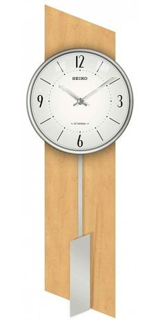 """The Seiko QXM485BLH Brookfield Contemporary Wall Clock is perfect for a modern environment at home or the   office. Light wood parallelogram back with a reversed silver stained moving pendulum. Accurate quartz musical   movement on the hour, the clock plays one of twelve melodies if you wish. Clock may be set to silent for office use. Two sets of melodies are available for selection on the control panel. Demonstration button;   Volume control; Pendulum. Size: H. 23 1/2"""" W. 8"""" D. 3 1/4"""""""