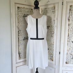 """Ralph Lauren dress Sz 16P petite NWT Ralph Lauren dress Sz 16P petite NWT. Gorgeous creamy white with vegan leather piping. Has back zip. Fully lined. Measures 35"""" in length. Bust approx 36-38"""". Waist approx 34"""". Hips approx 40"""". Shell 63% viscose 32% polyester 5% elastane. Lining 100% polyester #lisamariesvibe #petite #16P #ralphlauren #nwt Ralph Lauren Dresses"""