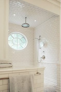 Subway  tile  - like the bright bathroom  - but would rather have bigger tile