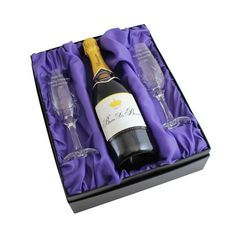 Personalised Memento Personalised Pair of Crystal Flutes and Champagne A pair of crystal champagne flutes and bottle of champagne set You can personalise each flute with any message up to 4 lines of 20 characters. The set also comes presented in a beautiful silk lined bo http://www.MightGet.com/january-2017-13/personalised-memento-personalised-pair-of-crystal-flutes-and-champagne.asp