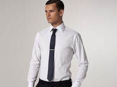 White pinstripe dress shirt with a tailored fit and spread collar.